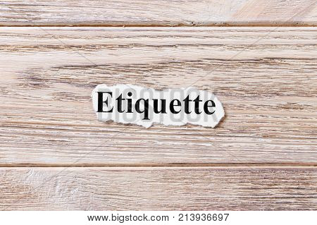 etiquette of the word on paper. concept. Words of etiquette on a wooden background.