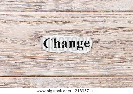 Change of the word on paper. concept. Words of Change on a wooden background.