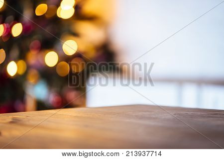 Christmas Holiday Background With Empty Rustic Table And The Bokeh Of The Living Room With The Chris