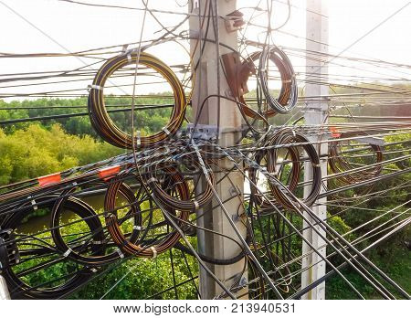 High-voltage poles, with cable tangle The clutter of wires, electric poles with electric wire, very entangled electricity.