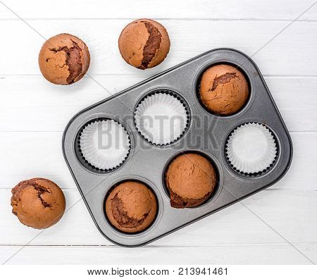 homemade brownie or chocolate muffins in baking pan