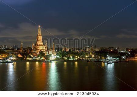Wat Arun Ratchawararam Ratchawaramahawihan or Wat Arun meaning Temple of Dawn on Chao Phraya River at night Bangkok Thailand