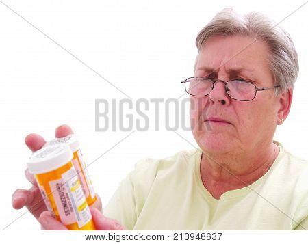 A senior citizen with prescription medication for health.