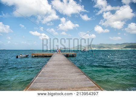 Pier With Wooden Deck In Sea In Philipsburg, St Maarten