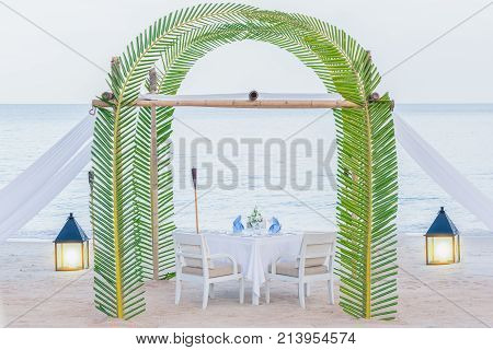 Romantic wedding dinner setting outdoor on the beach.