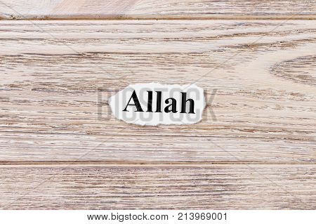 ALLAH of the word on paper. concept. Words of ALLAH on a wooden background.