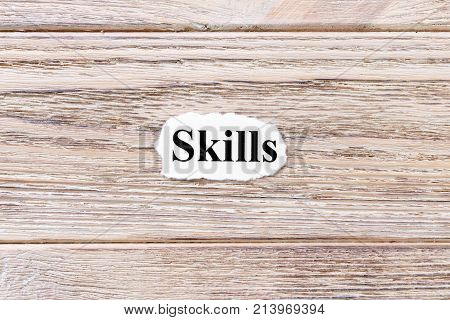 Skills of the word on paper. concept. Words of Skills on a wooden background.
