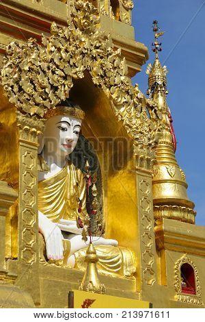 Buddha statue in Kyauktan Ye Pagoda Yangon river tributary Myanmar (Burma)