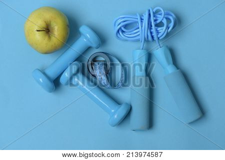 Apple, Tape, Dumbbells And Skipping Rope In Cyan Color