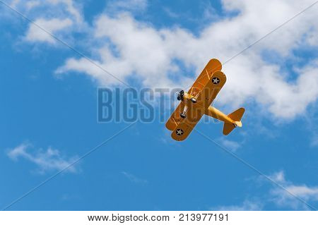 EDEN PRAIRIE MN - JULY 16 2016: N2S-1 Bush Stearman flies overhead. A trainer aircraft during WWII this plane was one of several flown by former president George H.W. Bush during his flight training