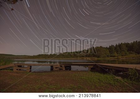 star trail over hartley pond in duluth, minnesota