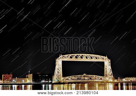 star trail over the historic aerial lift bridge in duluth, minnesota