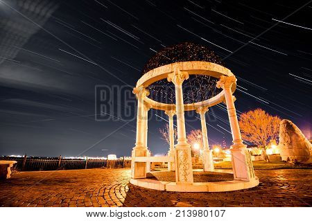 star trail over the rose garden pavillion in duluth, minnesota