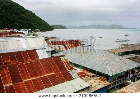 Rooftops of Labuan Bajo on Flores Island Nusa Tenggara Indonesia. The local economy in the town is centered around the ferry port and tourism. poster