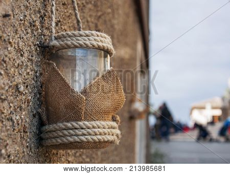 Vintage Candle glass lantern with rope hanging outdoor