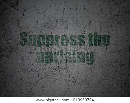 Political concept: Green Suppress The Uprising on grunge textured concrete wall background