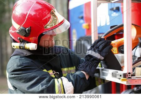 Belarus, Gomel City. Firefighting Of The Forest 06.04.2017.firefighter Retrieves Fire Hoses.the Brav