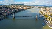 Aerial footage from a drone shows the historical Buda Castle near the Danube on Castle Hill in Budapest, Hungary. Bridge on the river. Aerial view. poster