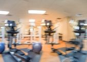Blurred fitness center with cardio machines weight strength training equipment medical ball large mirror. Empty gymnasium facility service room at hotel in Texas USA. Active lifestyle. Panorama poster