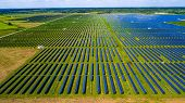 Huge Solar Panel Farm massive Solar array a clean renewable energy electricity producing Power Plant outside of Austin , Texas , USA powering clean sustainable energy from the Sun poster