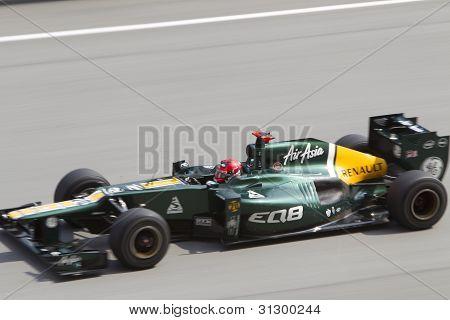 Heikki Kovalainen down the main straight