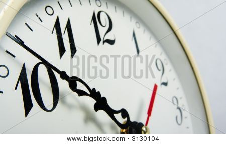 Detail of a clock with minute clock hand poster