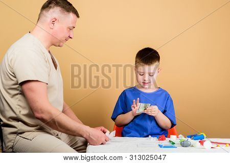 Medicine Concept. Kid Little Doctor Sit Table Medical Tools. Health Care. Medical Examination. Salar