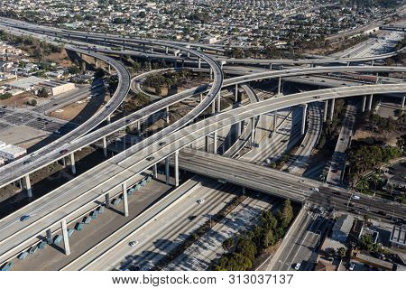 Aerial view of the Harbor 110 and 105 freeway interchange roads and bridges south of downtown Los Angeles in Southern California.