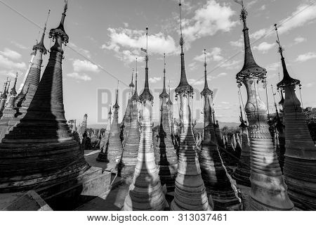 Black And White Picture Of Beautiful Old Stupas At Indein Temple Located In Inle Lake During Blue Sk