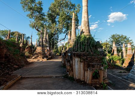 Horizontal Picture Of Ancient Stupas With Local Vegetation At Indein Temple Located In Inle Lake Dur