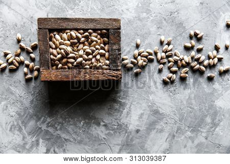 Pistachios Nuts In Wooden Box. Top View