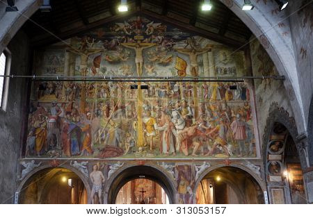 LUGANO, SWITZERLAND - JUNE 24, 2018: Passion and Crucifixion by Bernardino Luini, fresco in the Santa Maria degli Angeli church in Lugano, Switzerland