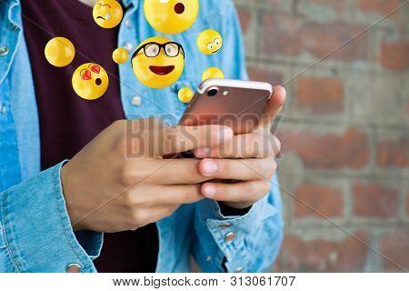Man Using Smartphone Sending Emojis