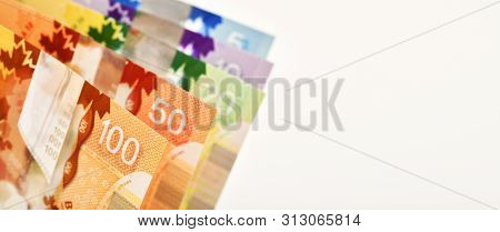 Canadian Banknotes On White Background, Copy Space