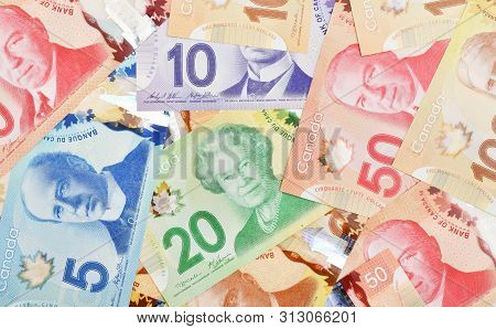 Close Up Canadian Banknotes On White Background