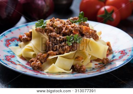Ragu bolognese, italian ground beef sauce with fettuccine or pappardelle pasta