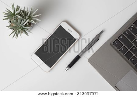 Mobile Phone Mockup, Top View Of White Office Desk Table With Mockup Blank Screen Smartphone And Com