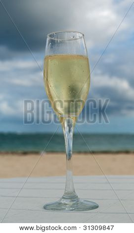 Glass Of White Wine On Caribbean Beach