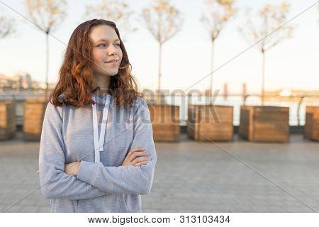 Outdoor Portrait Of Beautiful Smiling Teenager Girl 14, 15 Years Old, Golden Hour
