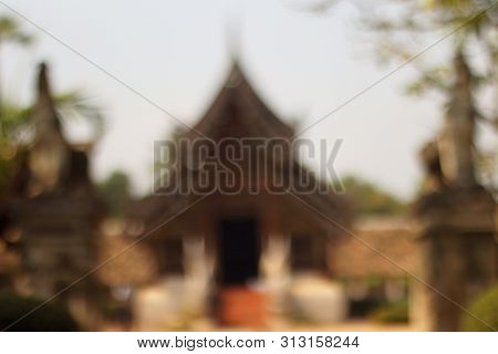 Blur Image Of Wat Ton Kain, Old Temple Made From Wood In Chiang Mai Thailand.