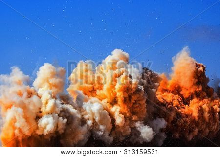 Rock Debris And Dust Clouds During Detonator Blasting In The Mining Industry