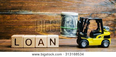 Wooden Blocks With The Word Loan And Forklift. Credit Provided By The Lender To The Borrower At A Ce