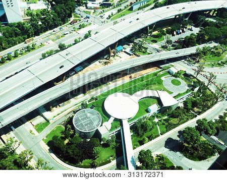 Aerial View Of Busy Flyovers, Roads And The Landscape Of Singapore