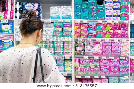 Bangkok, Thailand - July 21: Unnamed Female Customer Shops For Feminine Hygiene Products In Foodland