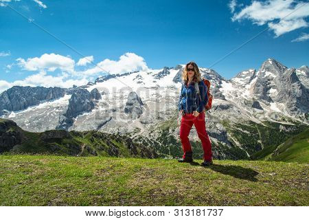 Hiking Woman In The Alps, Dolomites, Italy. Glacier Marmolada Trekking.
