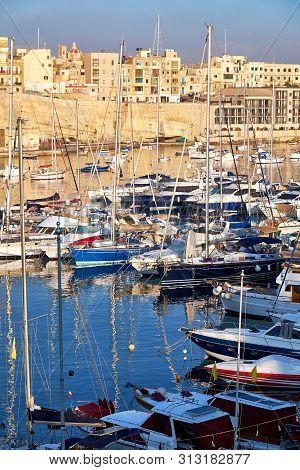 View On Malta Bay Between Kalkara And Birgu With Yachts At  Morning Time