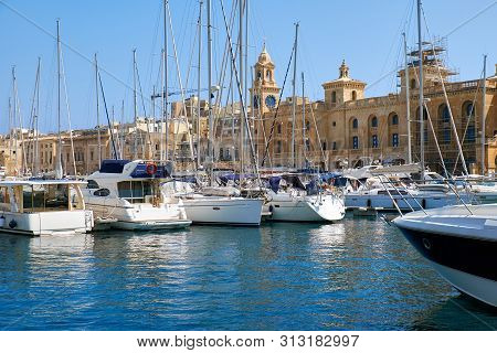 The Yachts And Boats Moored In The Harbor In Dockyard Creek In Front Of Malta Maritime Museum. Malta