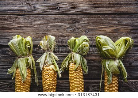 Fresh Corn On Wooden Table A Fresh Corn On Wooden Table A