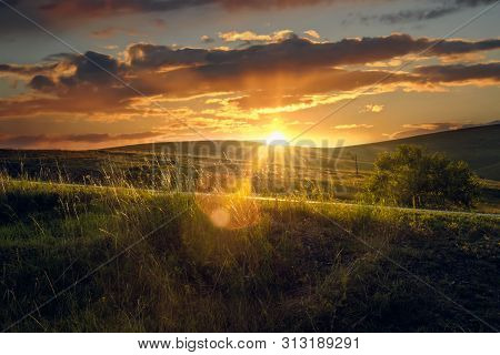 Sunset In Countryside Landscape. Meadow And Countryside Landscape. Nature Landscape. Sunset In Meado