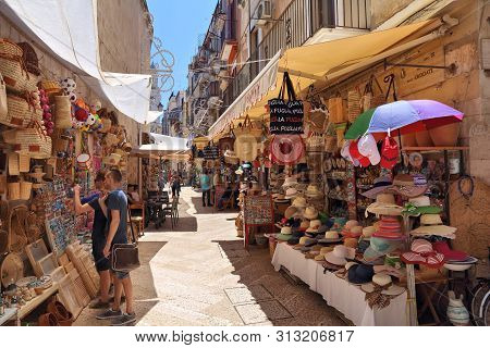Bari, Italy - May 28, 2017: People Visit Souvenir Stalls Of Old Town In Bari, Italy. Bari Is The Cap